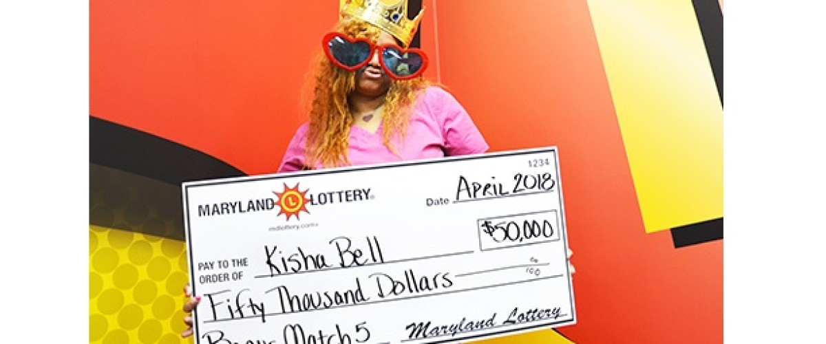 This time Kisha has a ticket and wins $50,000 Bonus Match 5 prize