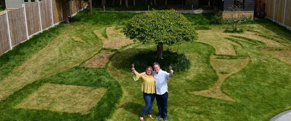 National Lottery scratch card winners mow champagne bottle into their lawn