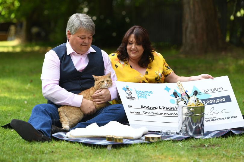 scratch card winners and their cat