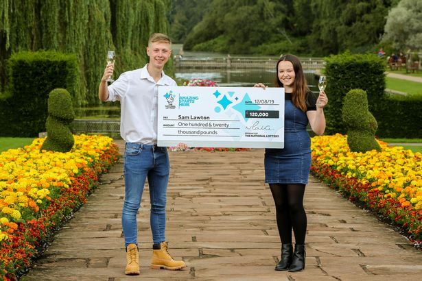 teenage lottery winner with cheque